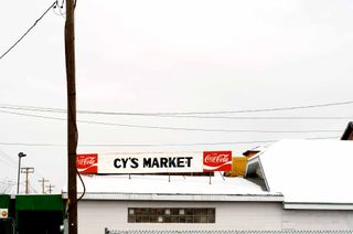 Cy's market sign